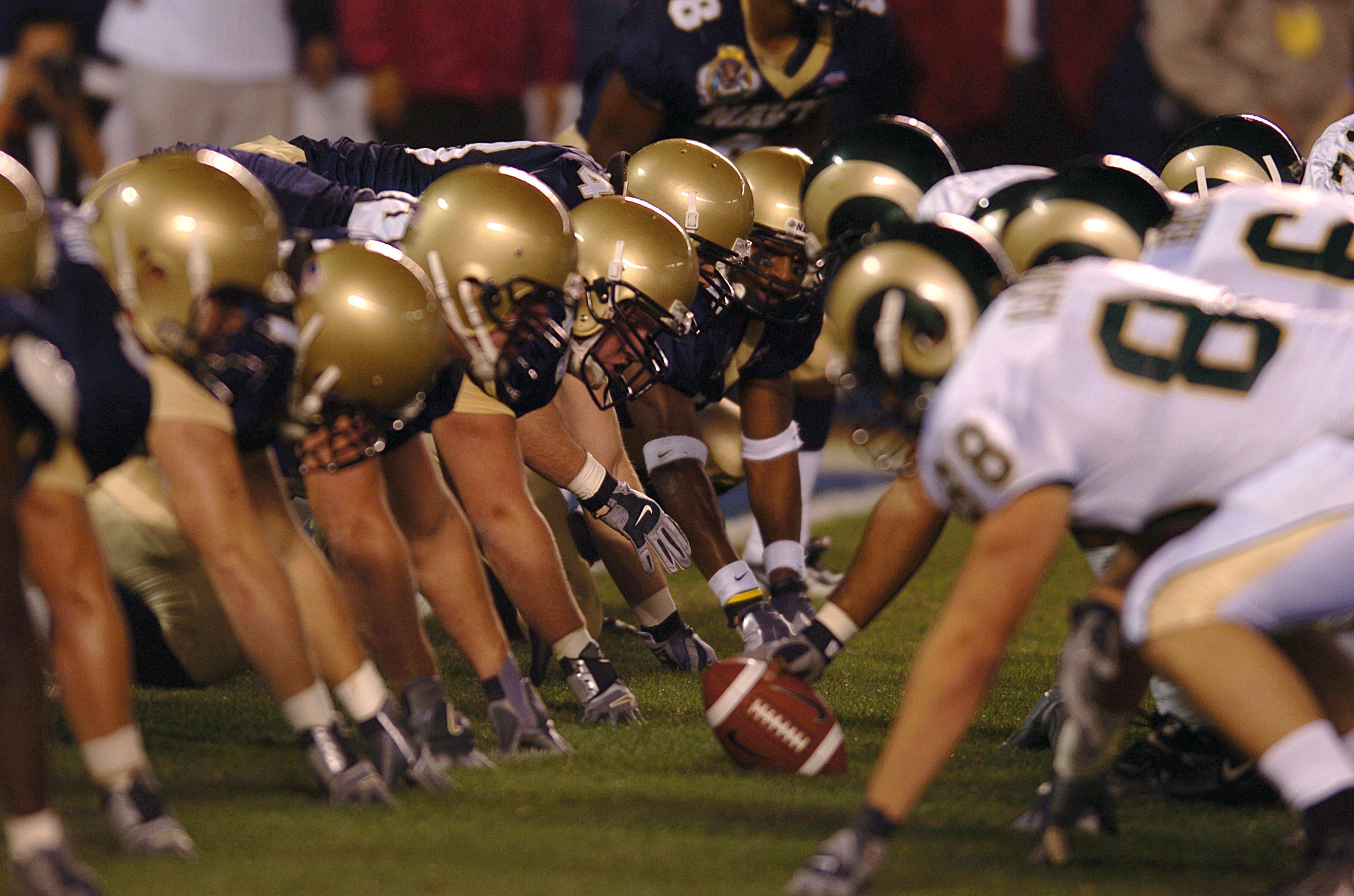 051222-N-9866B-079 San Diego (Dec. 22, 2005) - The U.S. Naval Academy Midshipmen position themselves defensively in preparation for a play by the Colorado State Rams. Navy defeated Colorado State 51-30 at the inaugural Poinsettia Bowl in San Diego at Qualcomm Stadium. U.S. Navy photo by Journalist 2nd Class Zack Baddorf (RELEASED)